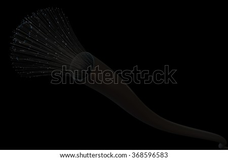A macro view of a fiber optics cable on a dark studio background - stock photo