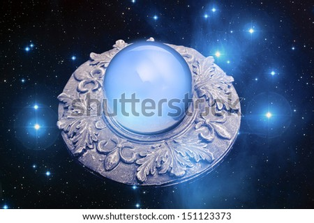 a magic circle with crystal ball and stars - star elements on this images is provided by NASA - stock photo