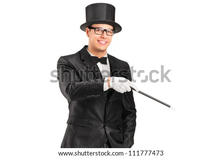 A magician holding a magic wand posing isolated on white background - stock photo