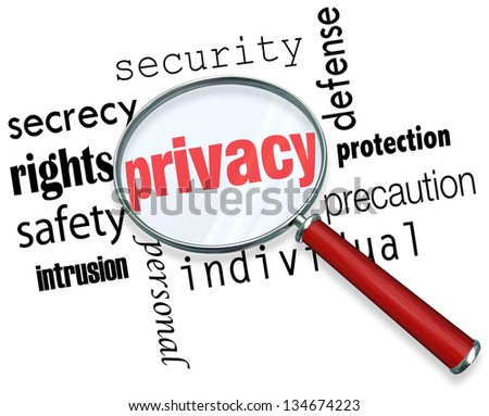 A magnifying glass hovering over the word Privacy and other related terms such as secrety, protection, security and identity - stock photo