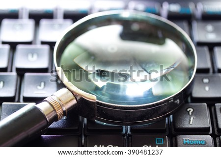 A magnifying Glass is searching the internet. Search engine optimization concept - stock photo