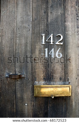 "a mail box with ""no advertising material"" on wooden door - stock photo"