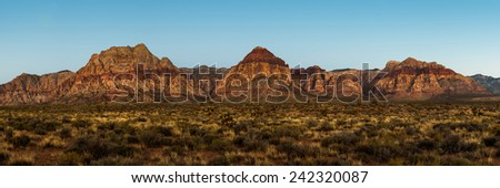 A majestic panoramic view of a mountain formation in Red Rock Canyon, Nevada, USA - stock photo