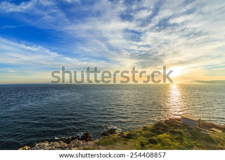 A majestic viev of a sunset ans a sea - stock photo