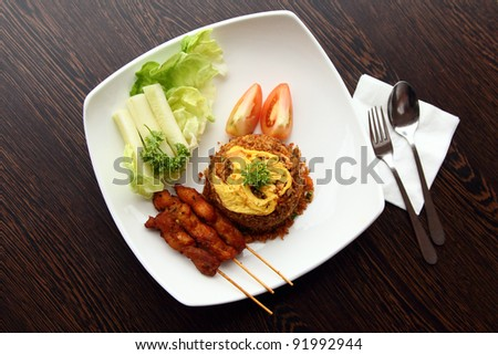 A Malaysian delicacy cuisine dish, Fried Rice with Chicken Satay - stock photo