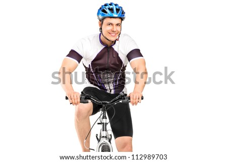 A male bicyclist posing on a bicycle isolated against white background - stock photo