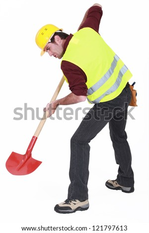 A male construction worker digging. - stock photo
