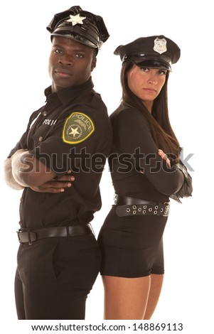 A male cop and a female cop with their backs together and arms folded - stock photo