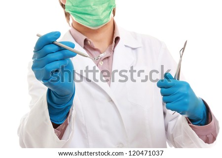 A male dentist showing ok isolated on white background - stock photo