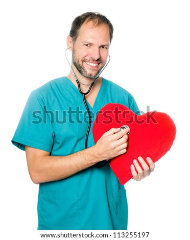 A male doctor examining a red heart shaped pillow with a stethoscope against white background - stock photo