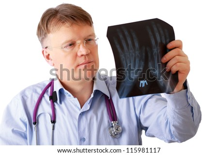 A male doctor examining x-ray isolated on white background - stock photo