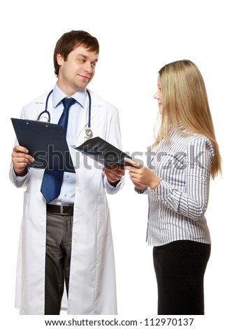 A male doctor with a patient, standing isolated on white - stock photo