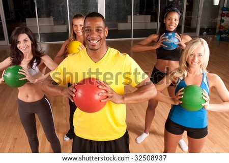 a male fitness intstructor leads a class - stock photo