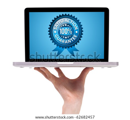 a male hand holding a laptop with Satisfaction Guarantee Label , isolated on white - stock photo