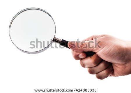 a male hand holding a magnifiyng glass isolated over a white background - stock photo