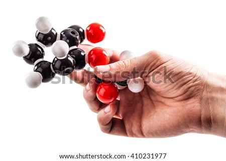 a male hand holding a molecule chemical structure model isolated over a white background - stock photo