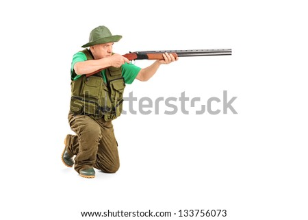 A male hunter shooting with a rifle isolated on white background - stock photo
