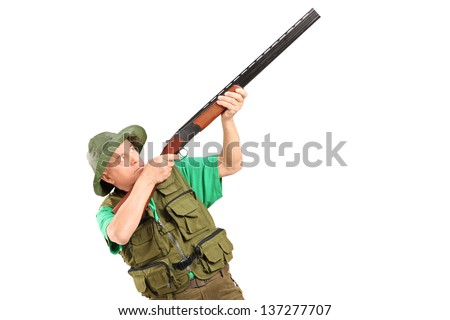 A male hunter shooting with a shotgun isolated on white background - stock photo