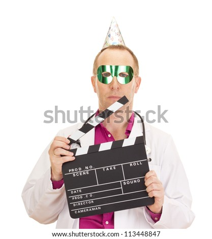 A male medical doctor with a clapperboard - stock photo