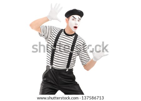 A male mime artist performing, isolated on white background - stock photo