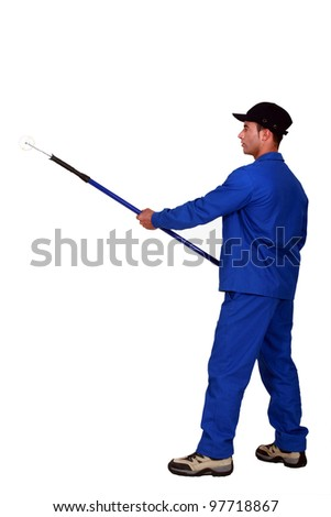 A male painter with a roller. - stock photo