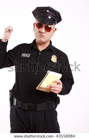 A male police officer about to write a citation. - stock photo