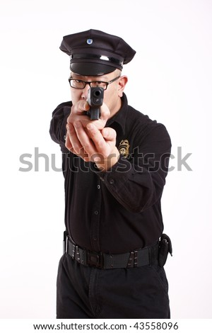 A male police officer aiming a pistol. - stock photo