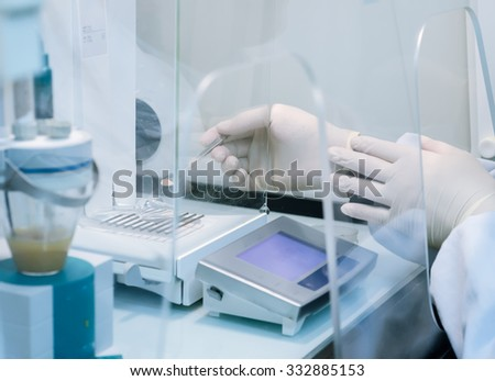 a male researcher doing research in a lab science test background - stock photo