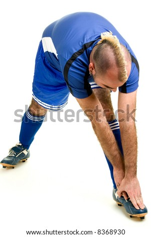 A male soccer player. Studio shot over white. - stock photo