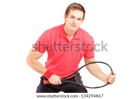 A male tennis player holding a racket isolated on white background - stock photo