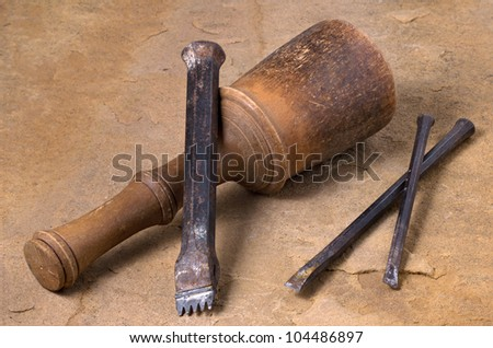 a mallet with three chisels - stock photo