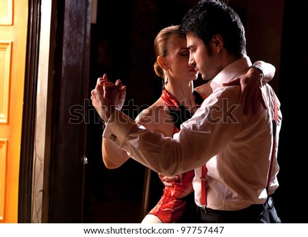A man and a woman dancing argentinian tango. Please see more images from the same shoot. - stock photo