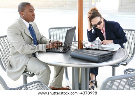 A man and woman business team taking a break - stock photo
