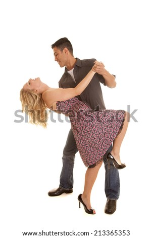 A man and woman dancing he is looking down at her. - stock photo