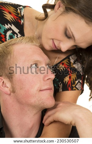 a man and woman looking into each others eyes. - stock photo