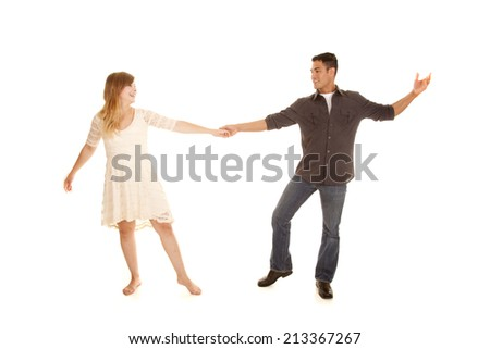 A man and woman with smiles on their faces dancing. - stock photo