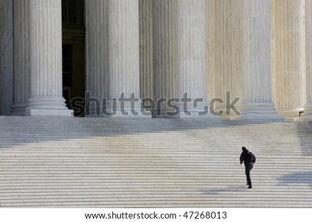 A man approaching the entrance to the Supreme Court in Washington DC - stock photo