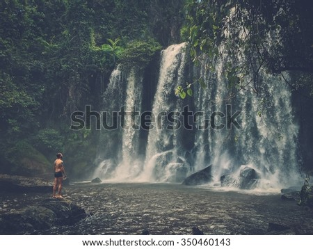 A man at the waterfall, Phnom Koulen at Siem Reap, Cambodia - stock photo