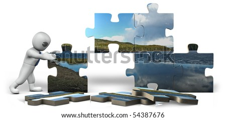 a man building a puzzle - stock photo