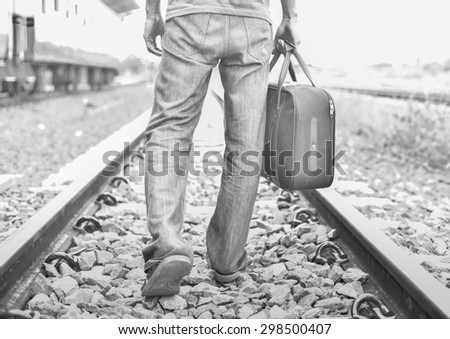 A man carrying baggage to walk on the railway.successful way concept.Business success way. - stock photo