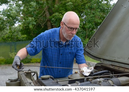 a man checked the engine oil level - stock photo