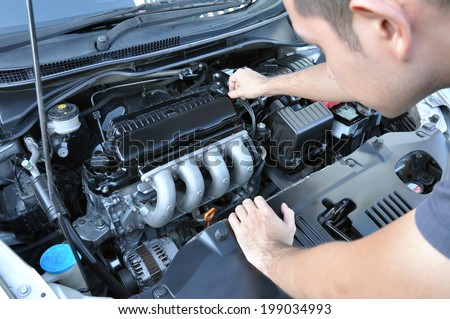A man checking car engine - stock photo