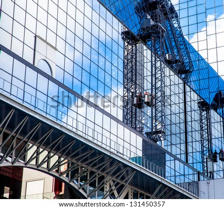 A man cleaning windows at Kyoto Station,It on a high rise building - stock photo