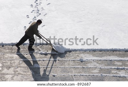 A man clearing a road - stock photo