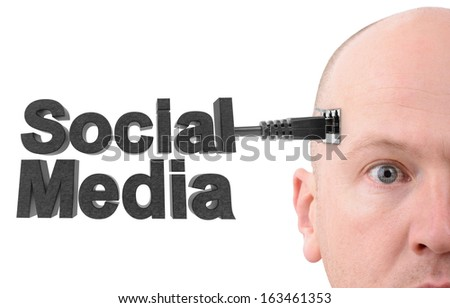 a man connected with a direct line to the social network - stock photo