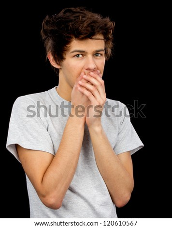 A man covering his mouth in a sorry manner. - stock photo