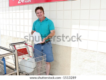 A man demonstrating the importance of water supplies in case of a disaster.  Could also be for recycling.  Horizontal with room for text. - stock photo