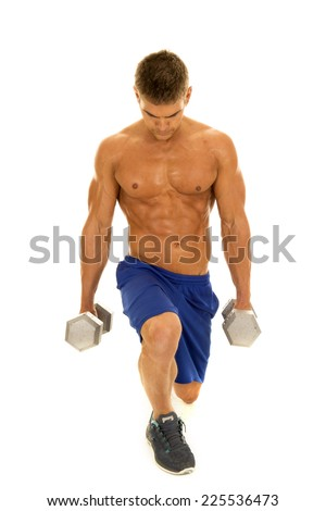 A man doing a lunge holding on to weights looking up with a smile. - stock photo