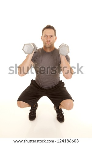 A man doing a squat while lifting weights. - stock photo