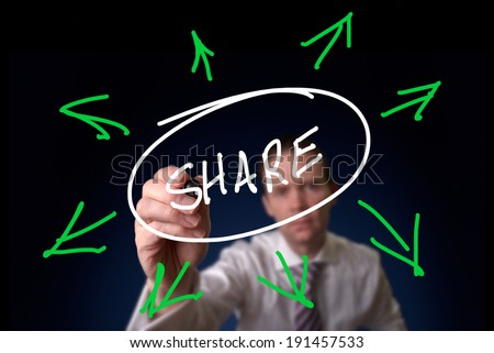 A man drawing Sharing concept on transparent wipe board. - stock photo